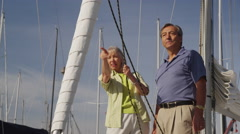Senior couple on sailboat together. Shot on RED EPIC for high quality 4K, UHD, Stock Footage