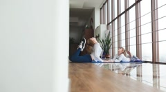 Mother makeing yoga with doughter in a gym Stock Footage