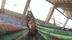 CLOSE UP: Young woman enjoying in a hammock Stock Footage