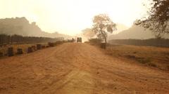 Vehicle on village road Stock Footage