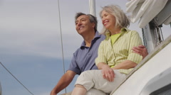 Senior couple on sailboat together. Shot on RED EPIC for high quality 4K, UHD, - stock footage