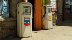 Stock Video Footage of old Antique chevron gas pumps in front of bar in Kingman, Arizona Americana