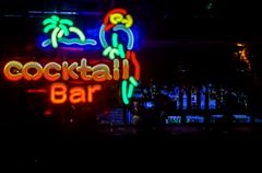 Cocktail Bar Neon Sign, Bar in the Background - stock photo