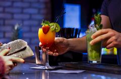 Barmen Serving Cocktails While Woman Waits to Pay Stock Photos