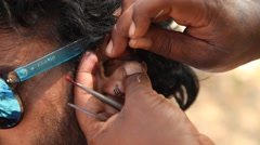 Young Male Cleaning Ear With A Cotton Swab Close Up-Shot Stock Footage