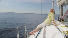 Senior woman relaxing on sailboat. Shot on RED EPIC for high quality 4K, UHD, Stock Footage