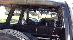 Cabine of a blown up jeep Stock Footage