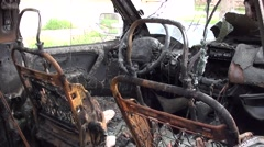 Front seats of a blown up jeep 2 Stock Footage
