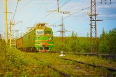 Electric Freight Train Approaching Polyarnye Zori, Russia Stock Photos