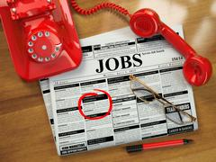 Stock Illustration of Looking for a job. Jobs vacancies. Newspaper with advertisments, glasses and