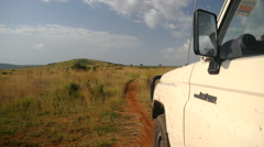 Driving on a dirt road in Kenyan safari - stock footage