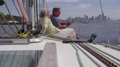 Senior couple relaxing on sailboat together. Shot on RED EPIC for high quality - stock footage