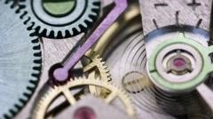 Closeup of Clockwork Mechanism inside a Watch Stock Footage