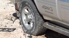 Punctured tire of 4x4 jeep 2 - stock footage