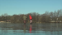 Ice fishermen on clear frozen lake lake Stock Footage