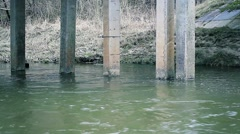 Old bridge supports in river Stock Footage