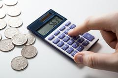 man counts budget on a white - stock photo