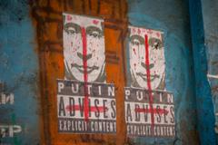 LVIV, UKRAINE - February 22, 2015: Putin advises explicit content graffiti - stock photo