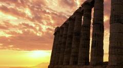 Golden sunset Ancient Temple of Poseidon Sounio Greece  pillars Stock Footage