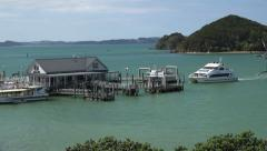 Tourist boats and ferry arrive back at Paihia, New Zealand Stock Footage