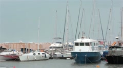 Old fishing harbor port in city on shore sea coast. Storm and waves at cloudy Stock Footage