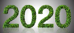 Year 2020, date made from green leaves isolated on white background. - stock illustration