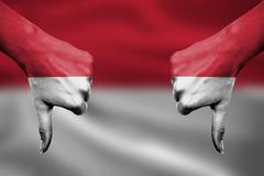 failure of Indonesia - hands gesturing thumbs down in front of flag - stock illustration