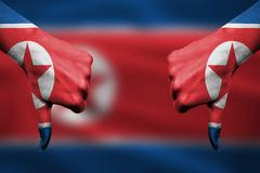 failure of  North Korea - hands gesturing thumbs down in front of flag - stock illustration