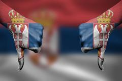 failure of Serbia - hands gesturing thumbs down in front of flag - stock illustration
