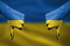 failure of Ukraine - hands gesturing thumbs down in front of flag - stock illustration