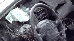 Zoom out steering wheel and cab of a blown up jeep 3 Stock Footage