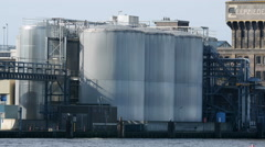 Great silver silo's by the water Stock Footage