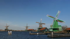 4 perfect Dutch windmills with blades turning Stock Footage