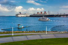 Stock Photo of View of ships in Long Beach Harbor from Shoreline Aquatic Park in Long Beach,