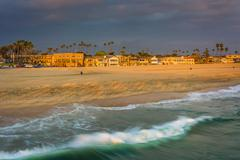 Waves in the Pacific Ocean and view of the beach at sunset in Seal Beach, Cal Stock Photos