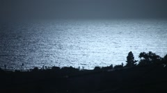 Hazy Pacific ocean realtime sunset surface shimmer 300mm zoomed Stock Footage