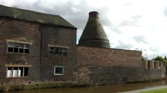 Derelict decay factory conical bottle kiln red brick skyline Stock Footage