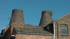 Conical pottery kilns victorian deep blue sky urban skyline Stock Footage