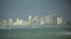 View of the stormy sea or ocean and a large metropolis city of skyscrapers Arkistovideo