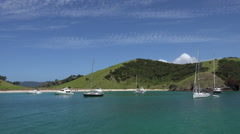 Yachts at anchor, Islands and beaches, Bay of Islands, New Zealand - stock footage