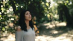 Scared woman running in the woods horror movie Stock Footage