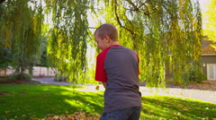 Stock Video Footage of Children playing in fall leaves. Shot on RED EPIC for high quality 4K, UHD,