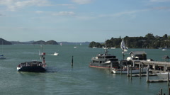 Okiato car ferry leaves Opua jetty, Bay of Islands, New Zealand Stock Footage