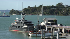 Boats at Opua jetty, Bay of Islands, New Zealand Stock Footage