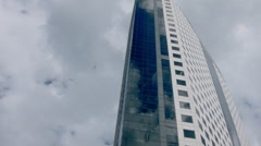 ESTABLISHING SHOT OF  HIGH RISE OFFICE BUILDING EXTERIOR WITH DRAMATIC SKY. Stock Footage