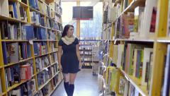 Happy Mixed Race Teen Walks Down Aisle, Finds The Right Book, Continues Walking Stock Footage