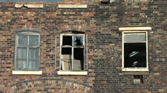 Broken windows derelict factory urban decay Stock Footage