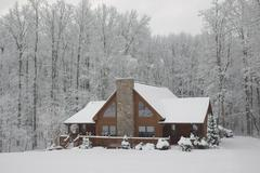 Log Home in Winter - stock photo