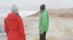 Iceland tourists at volcano mudpot hot spring - Beautiful Icelandic nature Stock Footage