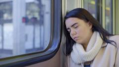 Mixed Race Teen Girl Sleeps On The Train On A Sunny Day In The City - stock footage